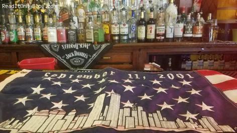 September 11th flag on the bar at McDermott's Pub in the Bronx