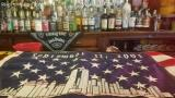 September 11th flag on the bar at McDermott's Pub in the Bronx