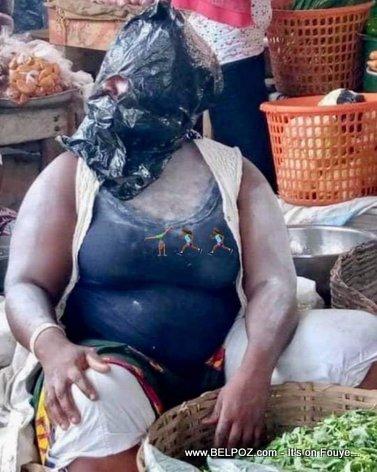 This Haitian merchant is not taking any chances with coronavirus