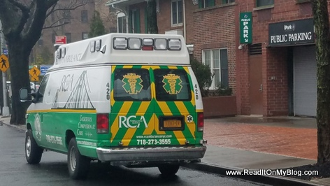 RCA service ambulance standing by in front of Atria Riverdale assisted living facility in the Bronx
